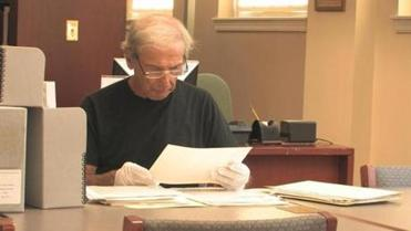 Walter M. Newman doing research at the American Jewish Historical Society office in Boston on the Dewey Stone project.