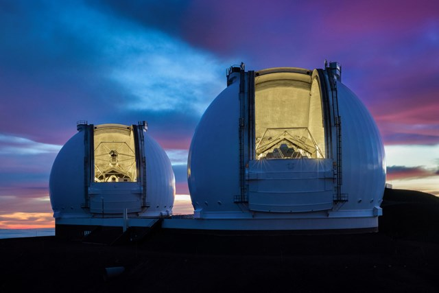 The twin telescopes of the Keck Observatory sit atop Mauna Kea in Hawaii. Ethan Tweedie Photography